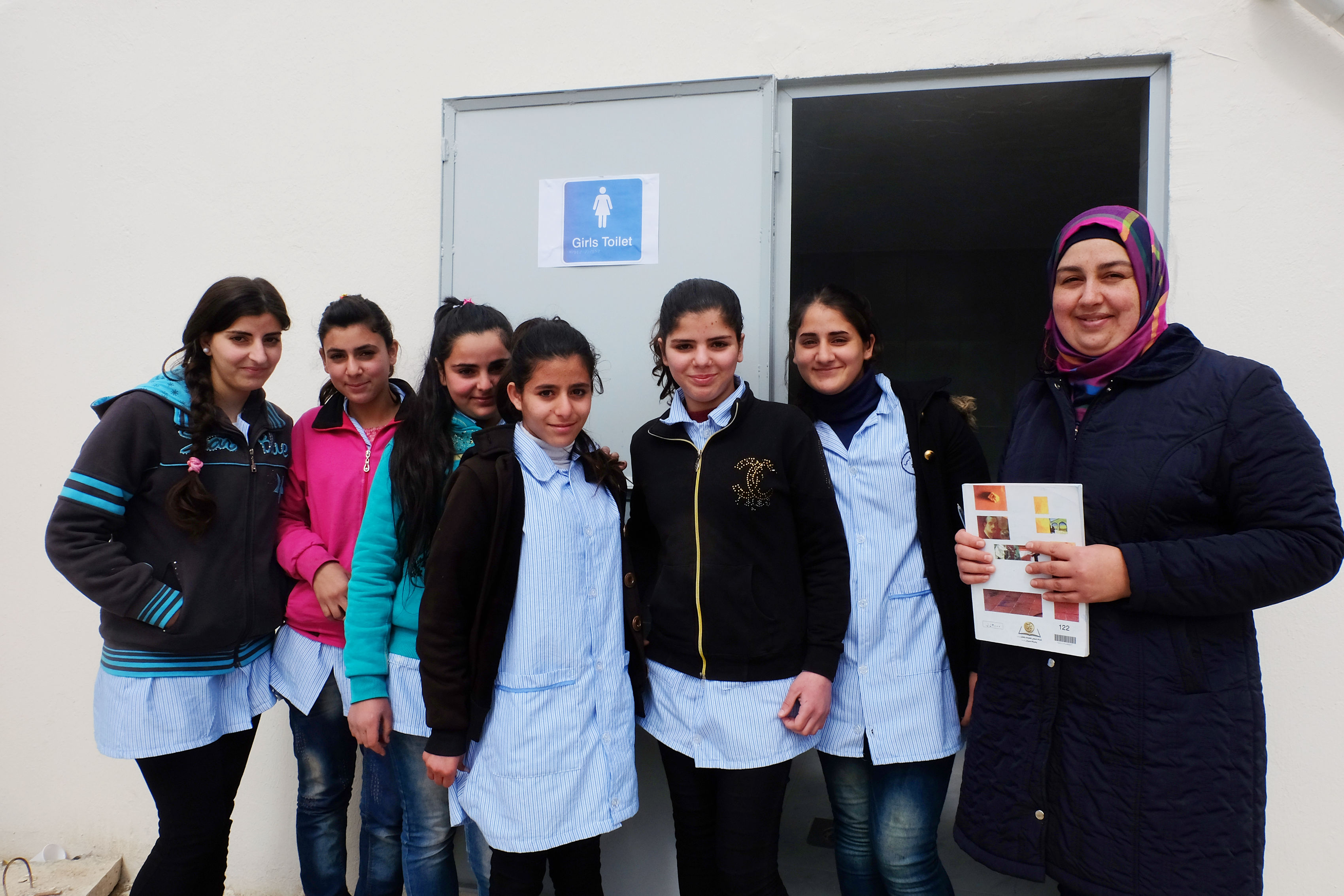 Pupils in front of sanitation facility