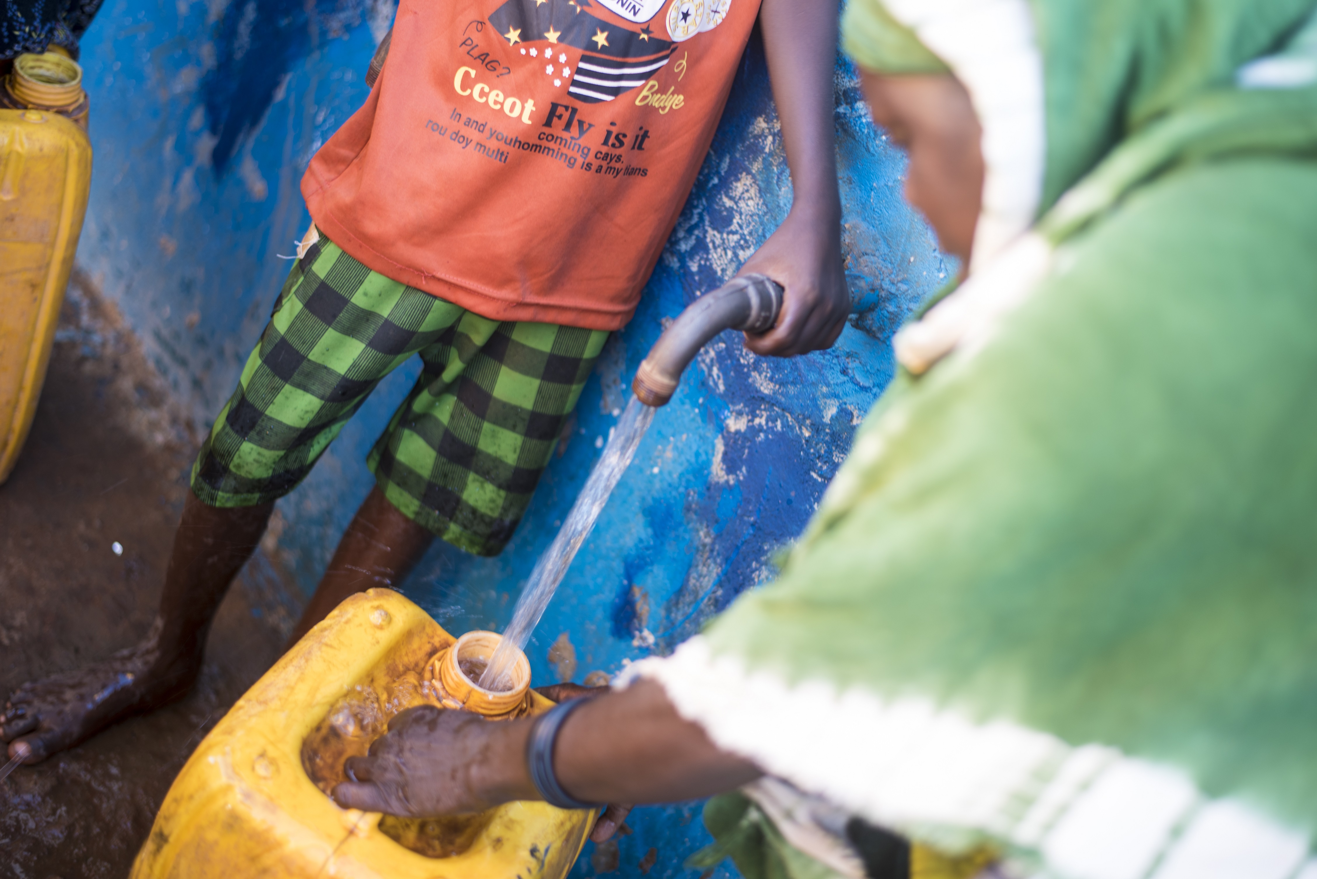 People obtain water from the water kiosk