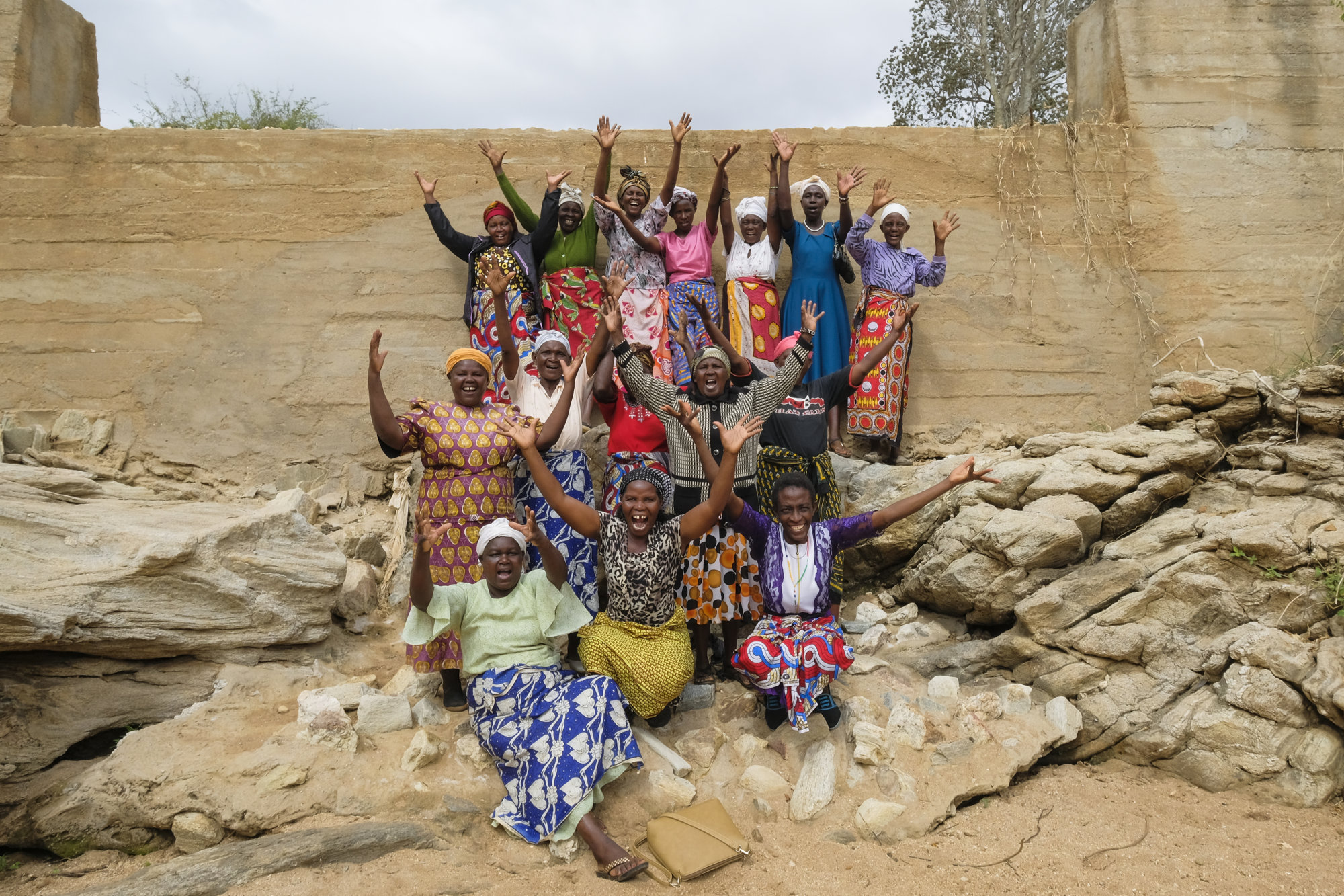 Mbukilye Ngukilye Widows Self Help Group in front of sand dam