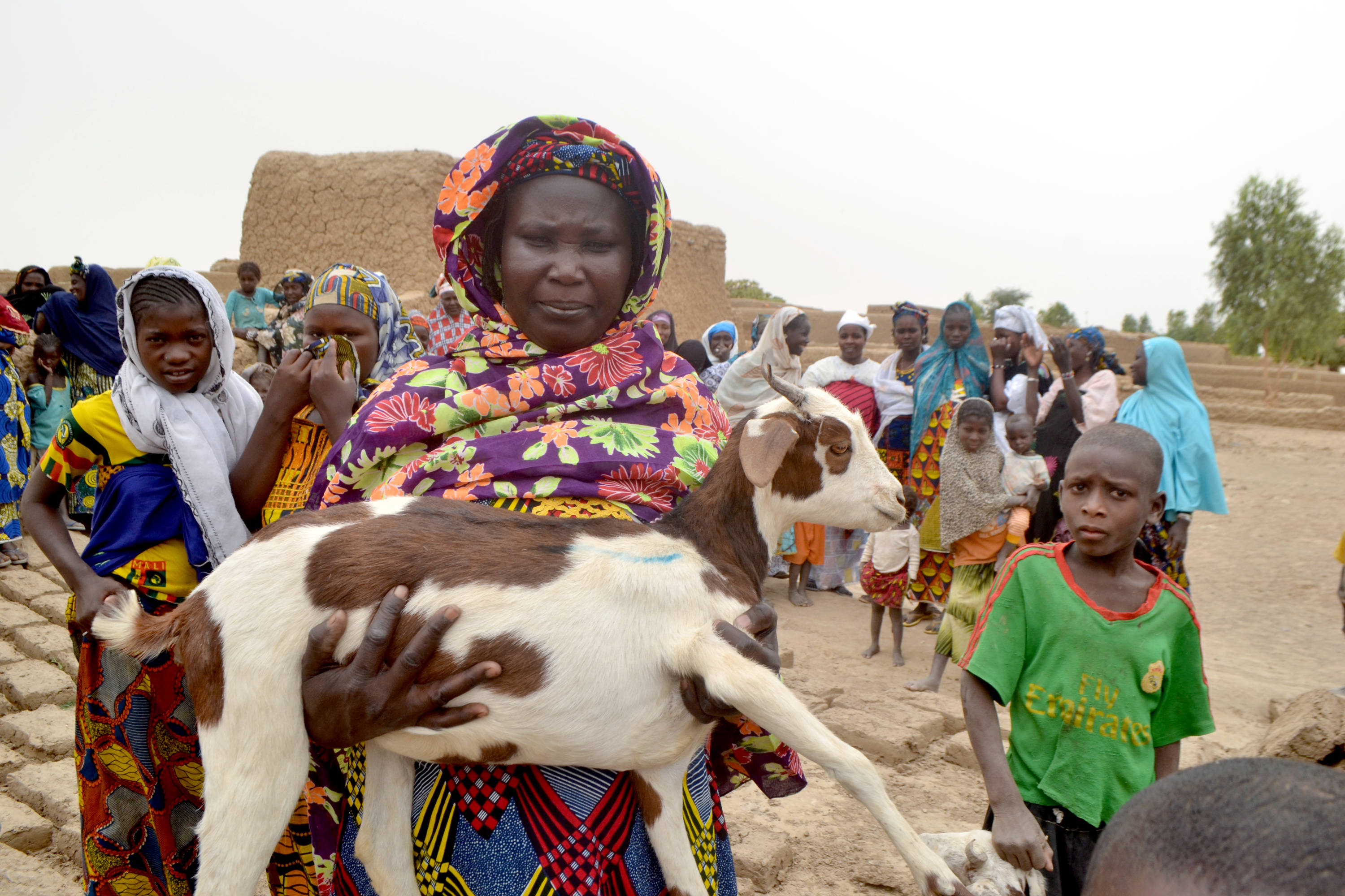 Woman with goat on her arms