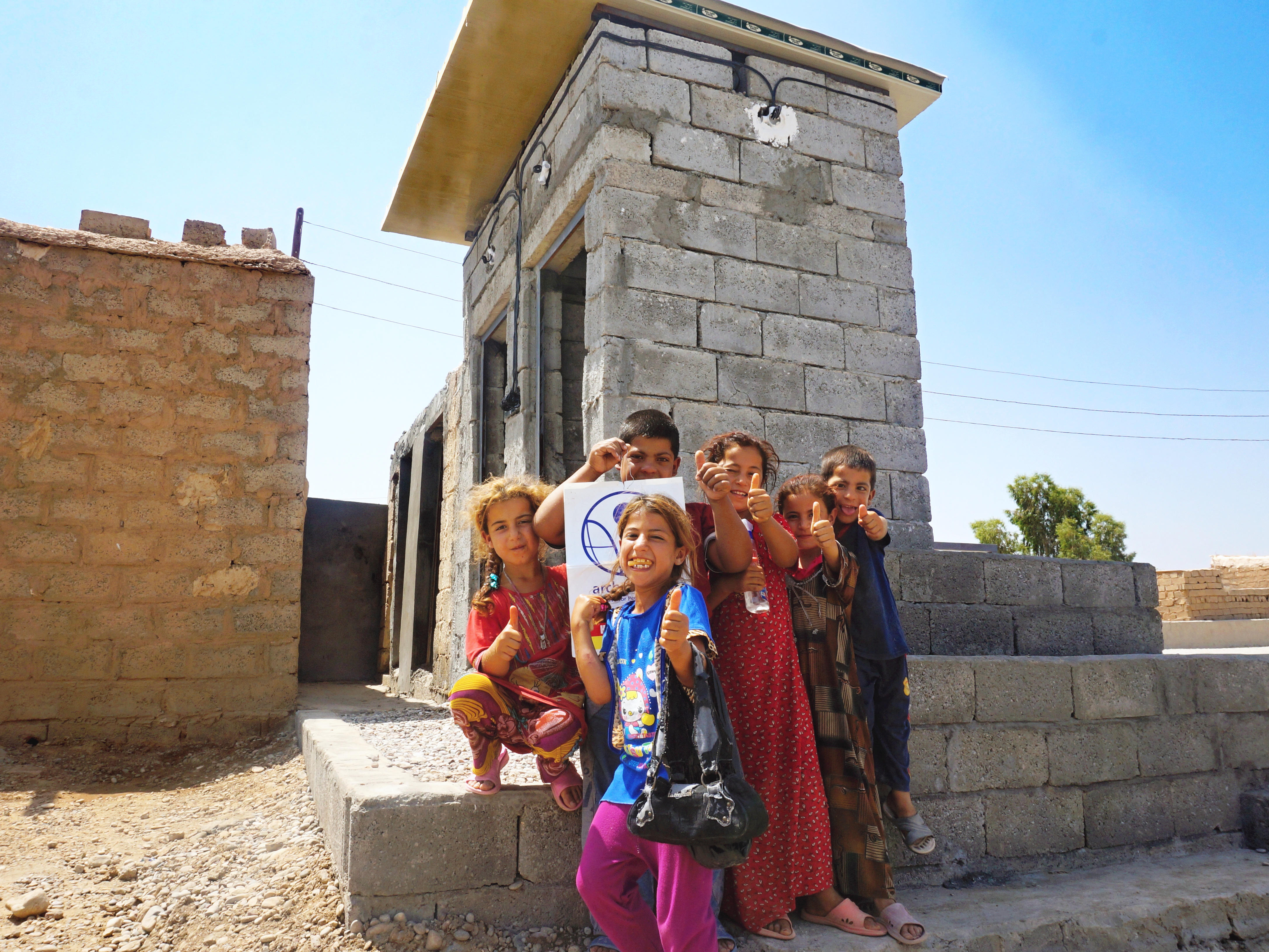 Girls attending Tel Mangel School in front of their new school latrine