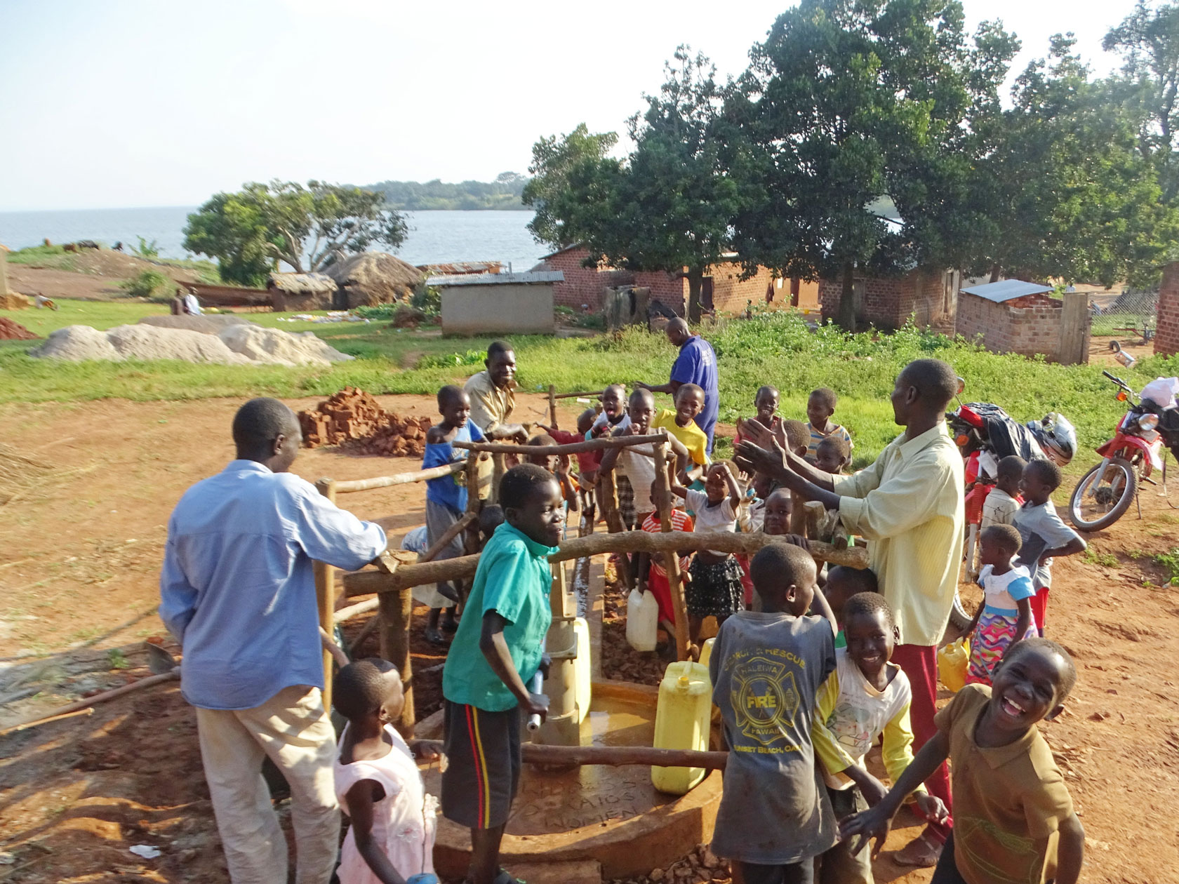 Many people gathered at a well to fetch water in Nangoma