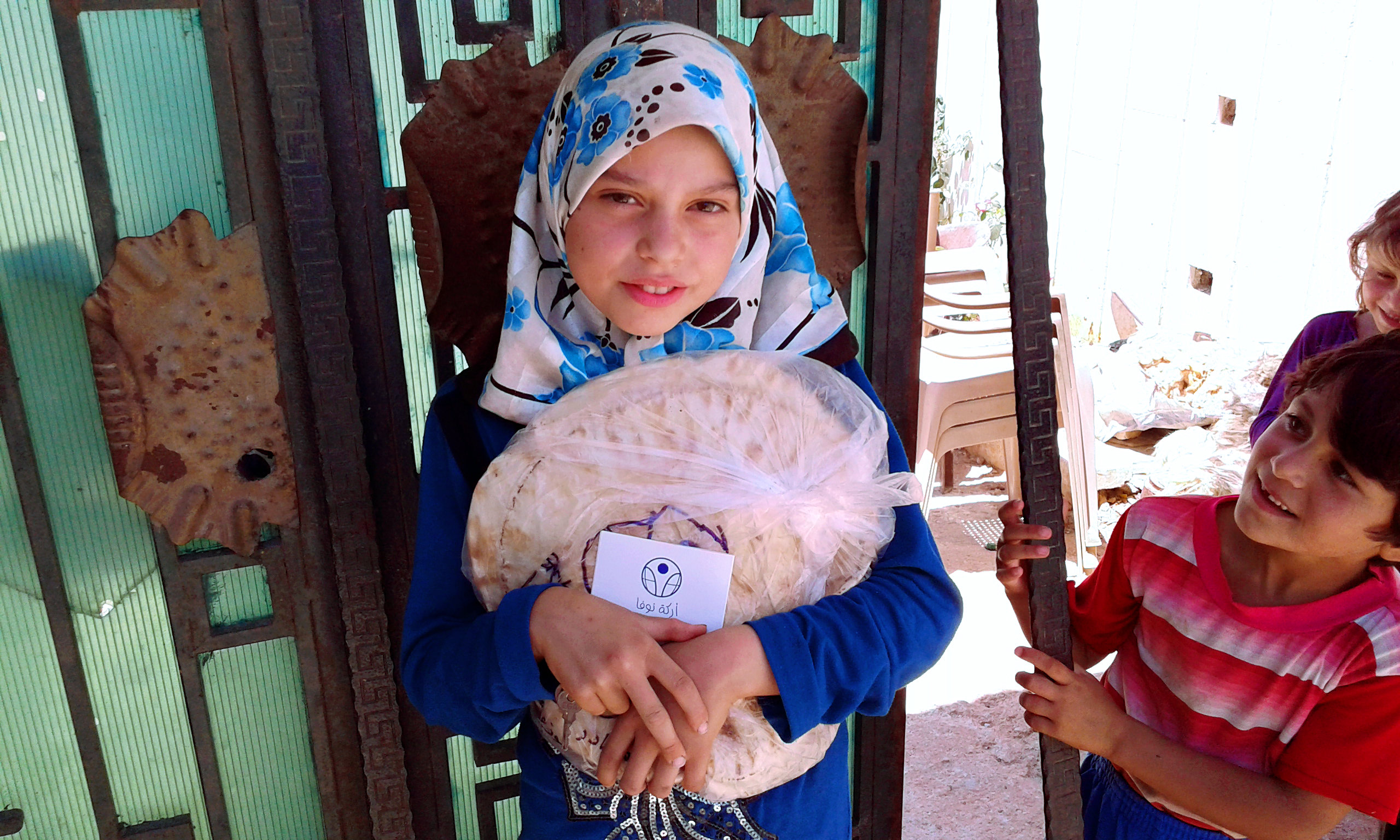 IDPs Syria - girl with bread