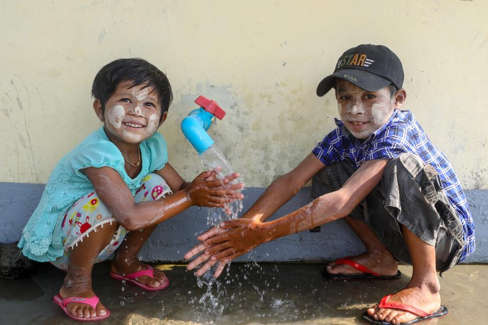 Children are washing their hands in Ma Kyin Myaing village, Bogalay township/Myanmar
