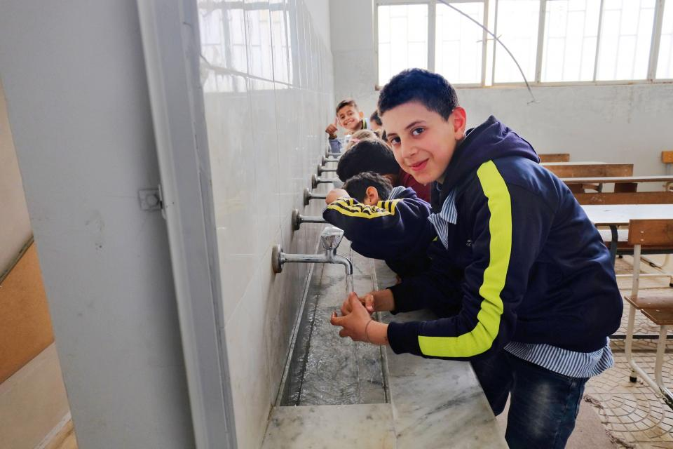 Title Lebanon - Boys using hand washing facility